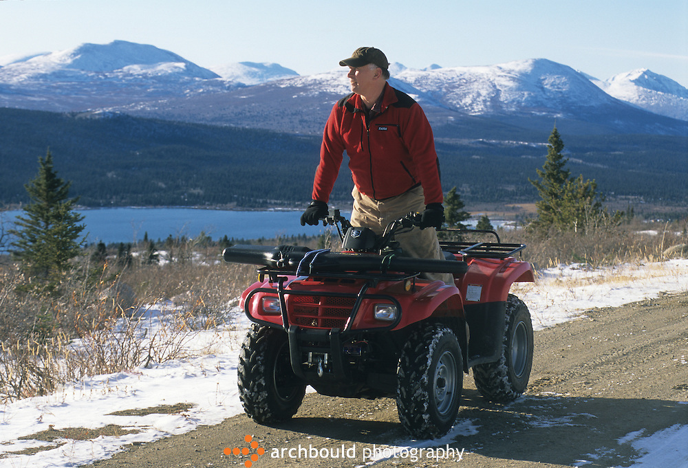 ATV rider looking over valley