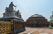 The statue on the left is part of the memorial to Prince Albert across the street from the Royal Albert Hall.  Royal Albert Hall is like the Madison Square Garden of London.  It's the venue all British musicians aspire to play at in their careers.  It was built as a tribute to Queen Victoria's husband, Prince Albert, after he passed away in the late 1800's.