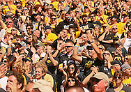 September 21 2013: Iowa Hawkeyes fans cheer during the second quarter of the NCAA football game between the Western Michigan Broncos and the Iowa Hawkeyes at Kinnick Stadium in Iowa City, Iowa on September 21, 2013. Iowa defeated Western Michigan 59-3.