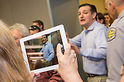A supporter snaps an iPad photo of Senator Ted Cruz at the South Carolina Tea Party Coalition convention on January 18, 2015 in Myrtle Beach, South Carolina. A variety of conservative presidential hopefuls spoke at the gathering on the third day of a three day event.