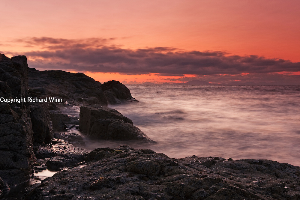 Sunset from the rocks near to Meanish Pier, Glendale in the northwest of the Isle of Skye. The outer isles are visible on the horizon.