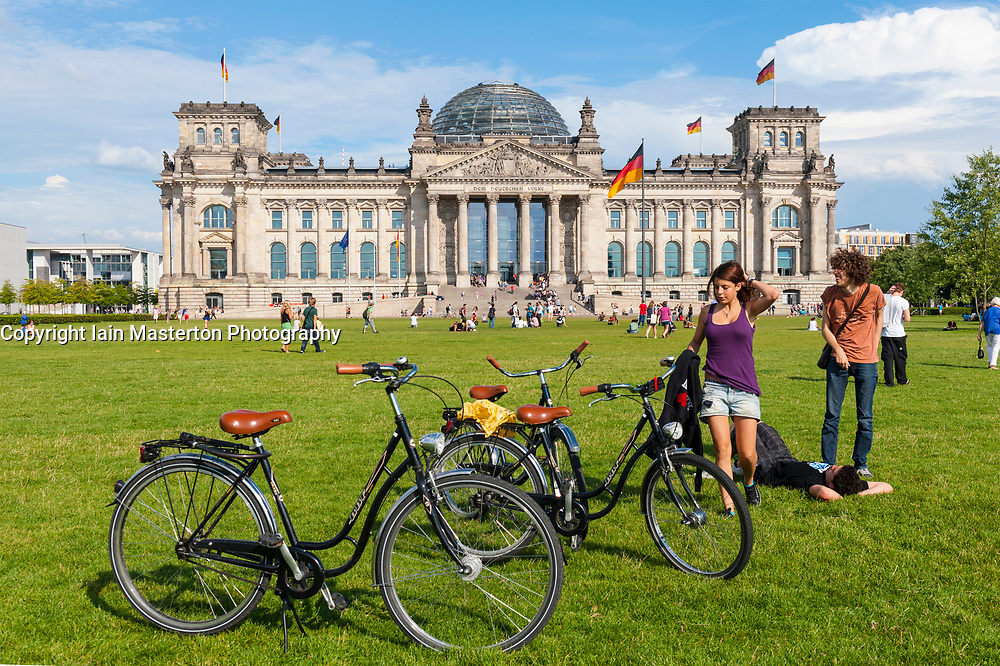 View of Reichstag during summer with many tourists in Berlin, Germany
