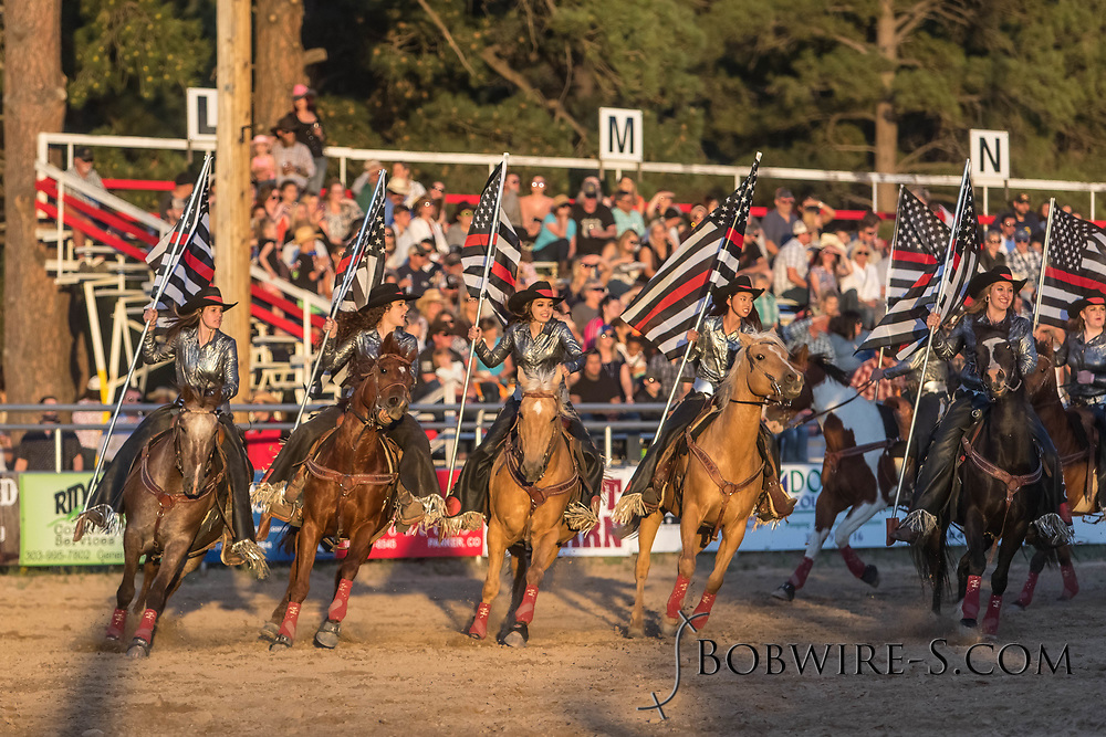 The Blazing Saddles drill team performs during the Xtreme Bulls event at the Elizabeth Stampede Rodeo on Friday, June 1, 2018.