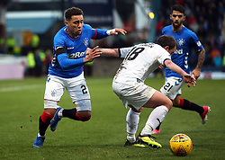 Rangers' James Tavernier (left) and Dundee's Paul McGowan battle for the ball during the Scottish Premiership match at Dens Park, Dundee.