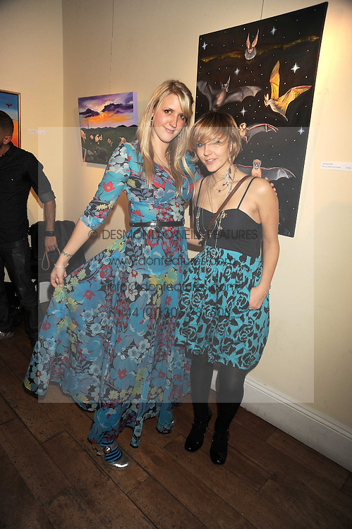 Left to right, artist SARAH-JANE BOLER and her sister CAMILLA BOLER at an exhibition of Sarah-Jane Boler's paintings entitled 'Life on The Farm' held at The Troubadour, 265 Old Brompton Road, London on 27th November 2008.