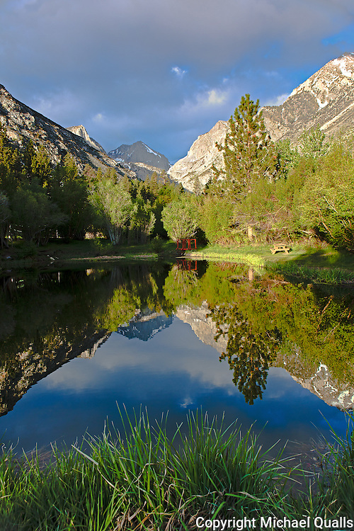 The Palisades reflected in the waters of the Glacier Lodge Pond.  Big Pine, CA.  USA