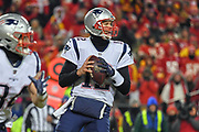 Jan 20, 2019; Kansas City, MO, USA; New England Patriots quarterback Tom Brady (12) handles the football during the AFC Championship game at Arrowhead Stadium. The Patriots defeated the Chiefs 37-31 in overtime to advance to their fifth Super Bowl in eight seasons. (Robin Alam/Image of Sport)