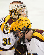 Shyler Sletta (31) and Katie Frischman share a moment on the ice following their overtime victory over Boston College in the 2013 NCAA Women's Frozen Four Semifinal..