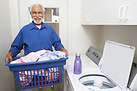 Elderly man with laundry basket