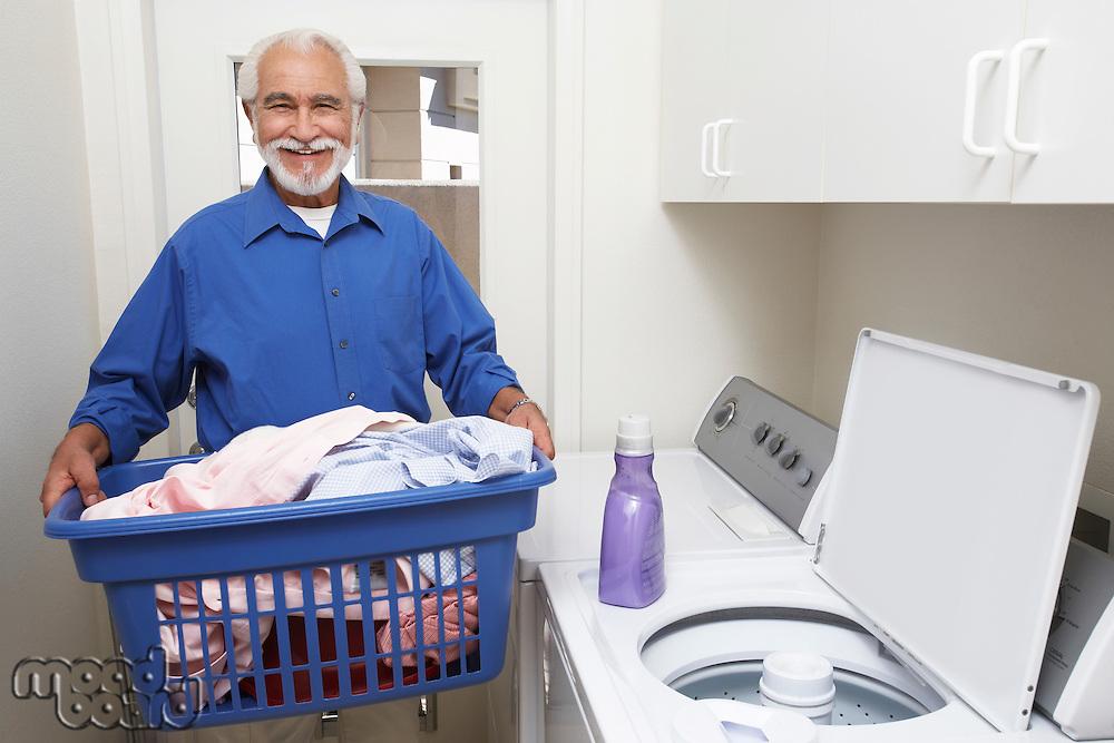 Elderly man with laundry basket