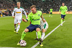 (L-R) Oscar Wendt of Borussia Mönchengladbach, Cedric Teuchert of FC Schalke 04, Alassane Plea of Borussia Mönchengladbach h DFL REGULATIONS PROHIBIT ANY USE OF PHOTOGRAPHS AS IMAGE SEQUENCES AND/OR QUASI-VIDEO. during the Bundesliga match between Borussia Monchengladbach and FC Schalke 04 at the Borussia-Park,  on September 15, 2018 in Monchengladbach, Germany