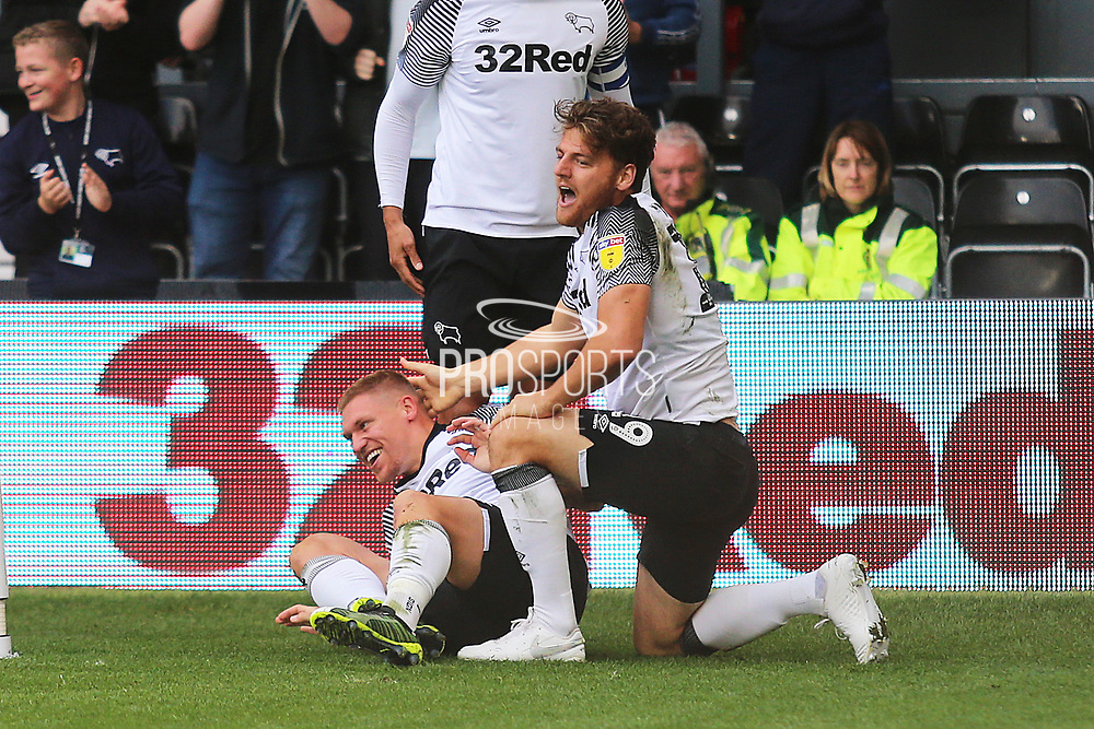 Derby County forward Chris Martin (19) scores a goal and celebrates with Derby County forward Martyn Waghorn (9) 1-0 during the EFL Sky Bet Championship match between Derby County and Birmingham City at the Pride Park, Derby, England on 28 September 2019.