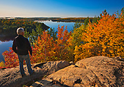 Hiker on a trail overlooking Lake Laurentian in the fall.  LAke LAurentian Conservation Area.<br />
