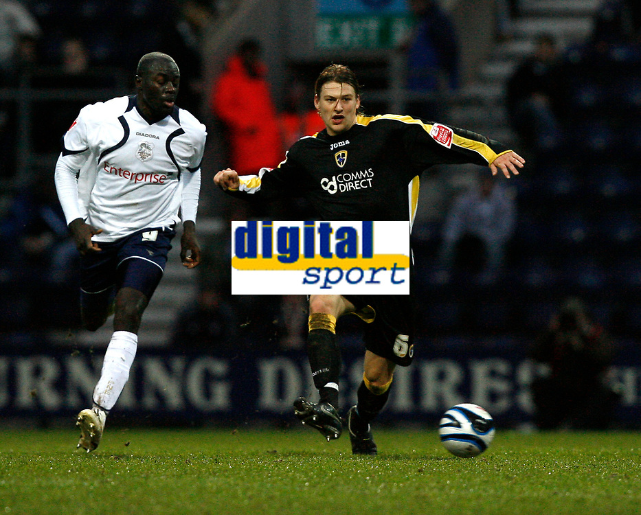 Photo: Paul Greenwood/Sportsbeat Images.<br />Preston North End v Cardiff City. Coca Cola Championship. 29/12/2007.<br />Cardiff's Glenn Loovens (R) takes the ball away from Patrick Agyemang
