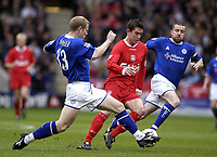Photo. Glyn Thomas.<br /> Leicester City v Liverpool. FA Barclaycard Premiership.<br /> Walkers Stadium, Leicester. 28/03/2004.<br /> Leicester City's Ben Thatcher (L) and Muzzy Izzet (R) put pressure on Liverpool's Harry Kewell.