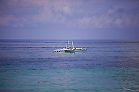 Boat on the crystal clear waters of Boracay island, Philippines.