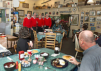 A valentine serenade by the Lakes Region Chordsmen Andy Buchanon, John Richardson, Harvey Beetle and Bob Farnham greeted patrons Kathleen and Robert Kammeraad at Kitchen Cravings Thursday morning.   (Karen Bobotas/for the Laconia Daily Sun)