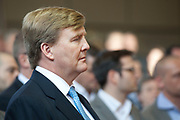 "Koning Willem-Alexander heeft de ceremoniële muntslag van de nieuwe Nederlandse euromunten – onder het toeziend oog van gastheer Frans Weekers, staatssecretaris van Financiën, en van Muntmeester Maarten Brouwer – bij  de Koninklijke Nederlandse Munt in Utrecht verricht . In totaal activeerde de koning acht muntpersen met de acht verschillende euromunteenheden die Europa kent. <br /> <br /> King Willem-Alexander present at the first ""printing"" of the new euro coins Dutch - under the watchful eye of host Frans Weekers, Financial Secretary, and Privy Maarten Brouwer - performed at the Royal Dutch Mint in Utrecht. In total, the king started eight coin presses with eight different coin units who knows Europe. <br /> <br /> op de foto / on the photo:  Koning Willem-Alexander / King Willem-Alexander"