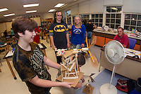 Storm Price, Rachel Griffiths and Kendra McCarter test out their windmill with Mr. White at Belmont Middle School during their engineering project.  (Karen Bobotas/for the Laconia Daily Sun)