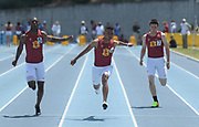Alexander Barnum of Southern California (center) wins the 100m in 10.29 as a part of a Trojans sweep with T.J. Brock, left, (second in 10.37) and Christian Sourapas (third in 10.73) during a collegiate dual meet against UCLA at Drake Stadium in Los Angeles, Sunday, April 29, 2018.