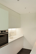 interior of new apartment, white domestic kitchen, detail