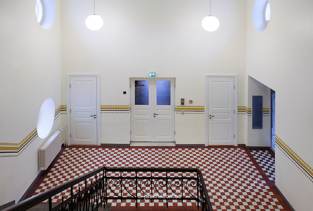 Stairwell with checked red and white floors in Tartu University, Estonia