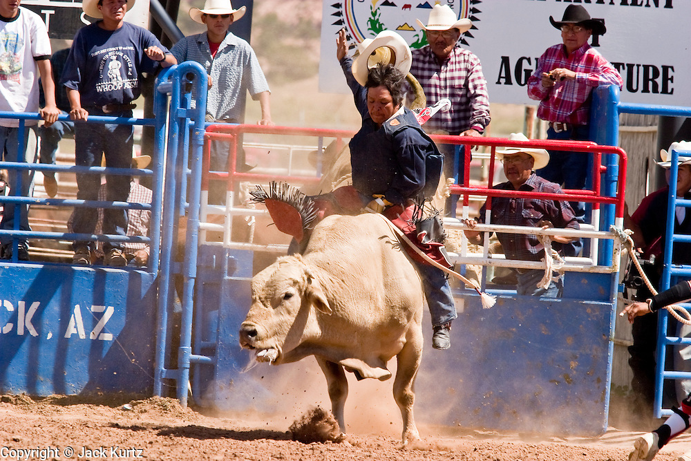 10 SEPTEMBER 2004 - WINDOW ROCK, AZ: Bull riding at the All Indian seniors rodeo, open to cowboys more than 40 years old, during the 58th annual Navajo Nation Fair in Window Rock, AZ. The Navajo Nation Fair is the largest annual event in Window Rock, the capitol of the Navajo Nation, the largest Indian reservation in the US. The Navajo Nation Fair is one of the largest Native American events in the United States and features traditional Navajo events, like fry bread making contests, pow-wows and an all Indian rodeo.  PHOTO BY JACK KURTZ