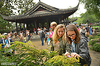 CALS students study a plant near the Hall of Distant Fragrance in the Humble Administrator's Garden in Suzhou.