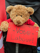A toy bear says 'vot labour and make June the end of May' - The May Day March from Clerkenwell Green ending with a rally in Trafalgar Square - against cuts and anti 'Trade Union laws. It was supported by several trade unions including UNITE, PCS, ASLEF, RMT, TSSA, NUT, FBU, GMB and UNISON as well as the Peoples Assembly, Pensioners' organisations and organisations representing migrant workers & communities.