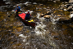 Paddling through rapids on the Ashuelot River in Surry New Hampshire USA