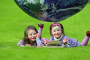 19/05/2013. Repro Free. Immrama Festival. Bookworms Beth Southgate, 5yrs and Charlotte Southgate, 4yrs from Lismore help launch the 'Free Family Fun' programme for the Immrama Festival of Travel Writing which will take place in Lismore, Co. Waterford from June 13 to 16 - further information can be found on www.lismoreimmrama.com. Picture: Patrick Browne<br />  <br />  <br /> Free Family Fun Programme Announced for Immrama – Lismore Festival of Travel Writing<br />  <br /> Lismore in county Waterford will be the place to be in mid June, as festivalgoers will be taken on a literal journey across the globe at the Lismore Immrama Festival of Travel Writing from June 13 to 16. A fun filled family programme was unveiled today (Sunday, May 19) at Lismore castle for this the eleventh year of the festival.<br />  <br /> Festivalgoers young and old will have the opportunity to listen to fascinating tales from some of the most famous travel writers in the world, younger Festival goers will have the opportunity to participate in story workshops and to join in the traditional 'Free Family Fun Sunday' afternoon programme.<br />  <br /> Some of the world's top international travel writers will descend upon the heritage town of Lismore enthralling audiences with tales of their travels and adventures including one of the world's most highly-regarded travel writers, Paul Theroux who will take to the stage at Immrama on Saturday, June 15 at 3pm. Perhaps best known for Ghost Train to the Eastern Star and The Great Railway Bazaar, his most recent work is The Last Train to Zona Verde: My Ultimate African Safari.<br />  <br /> Later on June 15, British writer, journalist and broadcaster, Simon Winchester OBE, will speak about his work and travel experiences. Having travelled to Canada and the US before university and Greenland while a student at Oxford, Simon worked for a time as a geologist in Uganda before becoming a journalist – a move he attributes to having read work by Lismore Immra