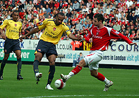 Photo: Olly Greenwood.<br />Charlton Athletic v Arsenal. The Barclays Premiership. 30/09/2006. Arsenal's Thierry Henry shoots past Charlton's Bryan Hughes