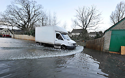 © Licensed to London News Pictures. Date 6 Jan 2014. Witney, Oxfordshire. Flooding in Witney. An industrial estate close to the River Windrush suffers flooding. Photo credit : MarkHemsworth/LNP
