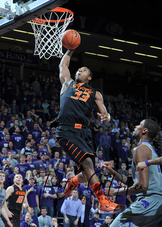 Sports Illustrated -- Guard Marcus Smart #33 of the Oklahoma State Cowboys drives in for a basket against the Kansas State Wildcats during the first half at Bramlage Coliseum in Manhattan, Kansas.