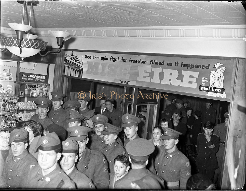 Soldiers attend 'Mise Eire'. George Morrison's film showed over twenty years of Irish history, from the 1890s to 1918, through existing archive material.  Its soundtrack, an orchestral score by Sean O'Riada, became hugely popular and is still available on CD..30.11.1960