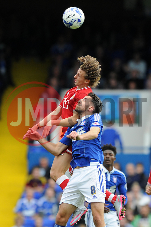 Luke Freeman of Bristol City challenges for the header with Cole Skuse of Ipswich Town - Mandatory byline: Dougie Allward/JMP - 07966 386802 - 26/09/2015 - FOOTBALL - Portman Road - Ipswich, England - Ipswich Town v Bristol City - Sky Bet Championship
