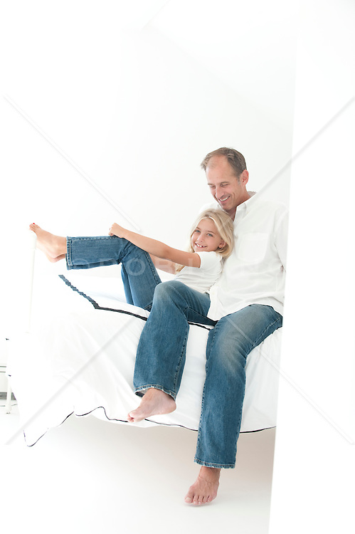 man with his daughter enjoying time together indoors