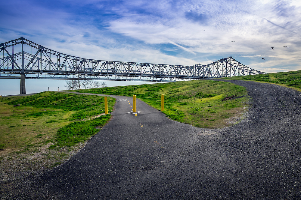 NEW ORLEANS - CIRCA FEBRUARY 2014: View of the Mississippi River Trail and the Crescent City Connection bridge over the Mississippi River in New Orleans.