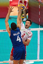 21-09-2014 POL: FIVB WK Finale Polen - Brazilie, Katowice<br /> Block Wallace de Souza (#4 BRA) - Angriff Michal Winiarski (#2 POL)<br /> <br /> ***NETHERLANDS ONLY***