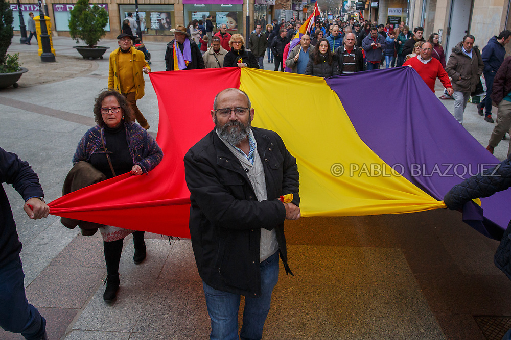 14/04/2018. Relatives and supporters carry a Spanish Republican flag along the city center during a homage to hand victims of Spain Civil War bodies exhumed in Cobertelada and Calata&ntilde;azor to their relatives on April 14, 2018 in Soria, Spain. La Asociacion Soriana Recuerdo y Dignidad (ASRD) 'The Soria Association for Memory and Dignity' celebrated a tribute to hand over the remains of civil war victims to their families. The Society of Sciences of ARANZADI helped with the research, exhumation and identification of the bodies, after villagers passed the information about the mass grave, 81 years after the assassination took place, to the ASRD. Seven people were assassinated around August 25, 1936 by Falangists, as part of General Francisco Franco armed forces, and buried in the 'Fosa de los Maestros' (Teachers Mass Grave) near Cobertelada, Soria, after being taken from prison of Almazan during the Spanish Civil War. Five of them were teachers in the region, and also friends of Spanish writer Antonio Machado. The other two still remain unidentified. Another body was assassinated by Falangists accompanied by a priest in 1936, and was exhumed on 23 September of 2017 near Calata&ntilde;azor, Soria. It belonged to Abundio Andaluz, a politician, lawyer and musician in Soria.<br /> Spain's Civil War took the lives of thousands of people on both sides, and civilians. But Franco continued his executions after the war has finished. Teachers, as part of the education sector, were often a target of Franco's forces. Spanish governments has never done anything to help the victims of the Civil War and Franco's dictatorship while there are still thousands of people missing in mass graves around the country. (&copy; Pablo Blazquez)