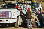 MANDAN, ND - The driver of a work truck confronts opponents of the Dakota Access Pipeline with a pistol after a convoy of protestors traveled from the Oceti Sakowin camp in Cannon Ball to an industrial site associated with the pipeline in Mandan, North Dakota on Nov. 12, 2016. Protestors stood in front of the truck to stop it from driving towards a larger group of demonstrators blocking the road and jumped onto the vehicle when it continued to drive.