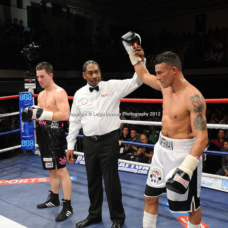 Robin Reid (white shorts) defeats Daniel Cadman in a 8x3min Super Middleweight contest at York Hall, Bethnal Green, London on 28th January 2012.Matchroom Sport. © Leigh Dawney Photography 2012.