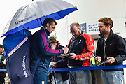Jos Buttler of England shelters from the rain under an umbrella as he signs his autograph for a fan ahead of the International Test Match 2019 match between England and Australia at Lord's Cricket Ground, St John's Wood, United Kingdom on 14 August 2019.