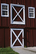 barn doors and windows; red with white trim; attractive; farm; Pennsylvania