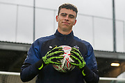 AFC Wimbledon goalkeeper Nicola Tzanev (13) warming up during the The FA Cup match between AFC Wimbledon and Doncaster Rovers at the Cherry Red Records Stadium, Kingston, England on 9 November 2019.