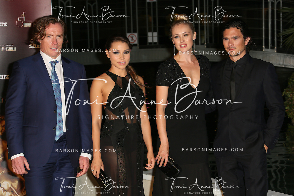 "MONTE-CARLO, MONACO - JUNE 10:  Toby Stephens, Jessica Parker Kennedy, Hannah New and Luke Arnold attend ""Black Sails STARZ"" Party  at the Monte Carlo Bay Hotel on June 10, 2014 in Monte-Carlo, Monaco.  (Photo by Tony Barson/FilmMagic)"