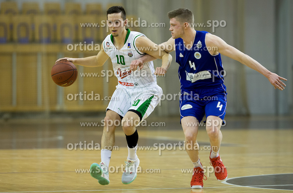 Jure Pelko #10 of KK Union Olimpija vs Jan Rebec of LTH Castings during basketball match between KK Union Olimpija Ljubljana and KK LTH Castings Skofja Loka in Round #20 of Liga NovaKBM 2016/17, on January 17, 2017 in Arena Tivoli, Ljubljana, Slovenia. Photo by Vid Ponikvar / Sportida
