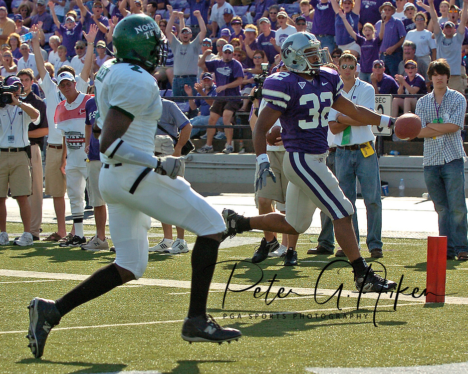 Kansas State runnig back Donnie Anders (32) scores on a 17-yard run, past North Texas defender Dominique Green (2) late in the fourth quarter.  Kansas State defeated the Mean Green of North Texas 54-7 at KSU Stadium in Manhattan, Kansas on September 24, 2005.