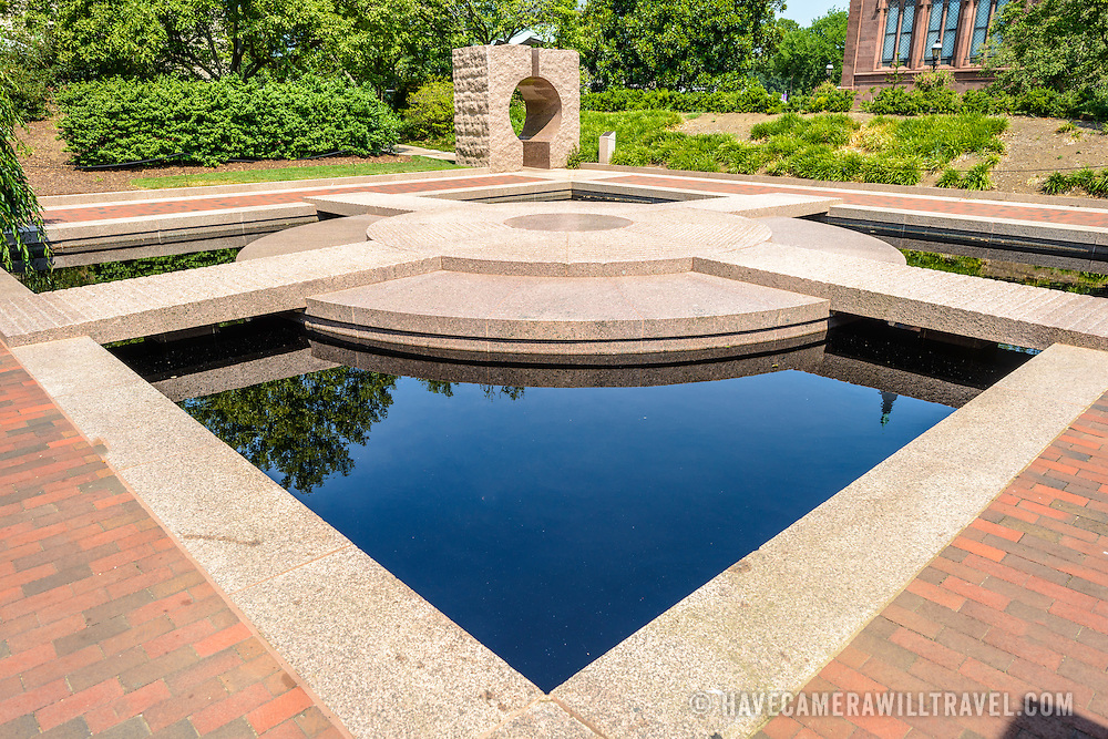 Moongate Garden Smithsonian Castle Gardens Pond. The Moongate Garden, behind the Smithsonian Castle, is modeled on the Temple of Heaven, a Ming Dynasty landscape and structure in Beijing.