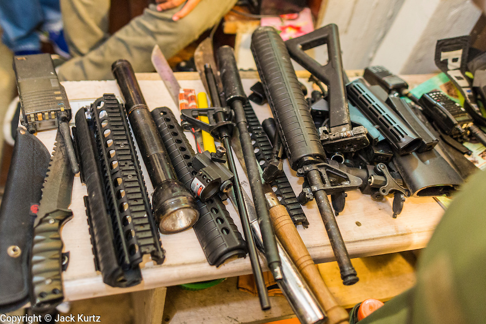 17 JANUARY 2014 - BANGKOK, THAILAND:  Part of a weapons cache recovered in an abandoned building officials believe was used to plan an IED attack on anti-government protestors. The attackers were not found but officials claim to have found a weapons cache in an abandoned building nearby. Friday was day 5 of the anti-government Shutdown Bangkok protests. The protest, led by the People's Democratic Reform Committee, is calling for the suspension of elections pending political reform in Thailand. There was violence at several sites in Bangkok Friday, including running battles between government opponents and supporters at one site and an IED attack by unknown assailants on anti-government protestors at another site.   PHOTO BY JACK KURTZ